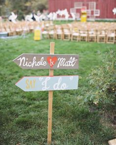 To incorporate their fun-loving flair into their wedding decor, this crafty couple made colorful signage guiding guests to the various parts of the celebration.