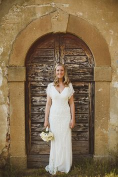 A rustic style wedding in Tuscany, Italy, with a bride wearing an elegant beaded gown by Eliza Jane Howell. Photography by Ed Peers.