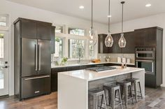 L shaped modern kitchen with island and thassos quartz counter