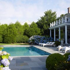 Love the stone patio colors and shape of the stone, as well as the rectangular pool shape and hydrangeas.  Would want more symmetry for the patio around the pool.  Very classic look.