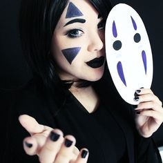 No-Face From Spirited Away (Halloweekend costume: this make-up and easy mask, black crop top, and black running shorts)