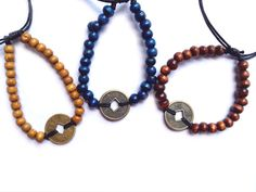 Wooden Beaded Talisman Bracelets -$2.50 - Heaven and Earth represented in these Chinese Coins with Blue, Brown or Tan Wood Beads