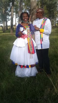The bride and groom in their Ndebele inspired wedding attire. Sepedi Traditional Dresses, African Traditional Wedding Dress, Traditional African Clothing, Traditional Wedding Attire, African Print Dresses, African Print Fashion, African Wear, African Clothes, Sister Wedding