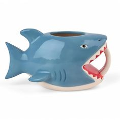 Would you lurky there... out of the blue our Shark Bite Me Coffee Mug will happily reveal your true feelings! This shark shaped mug features a graphic on its under belly - just tip it back to make you