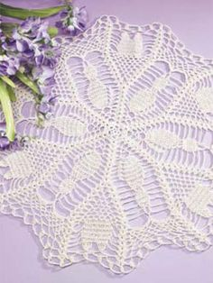 "Crochet. Purr-fect for all cat lovers, our lacy doily will bring a lighthearted touch to any room in your home. Size: 20 1/2"" diameter. Skill Level: Easy"
