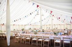 i am hating the idea of a tent even though i want a outdoor wedding.  the flags are cute.
