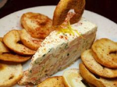"""Seafood """"Cheesecake"""" - This recipe uses wheat crackers in the crust and the filling is cream cheese, minced clams, shrimp or crabmeat, sour cream and cheddar cheese. Great spread on crackers"""