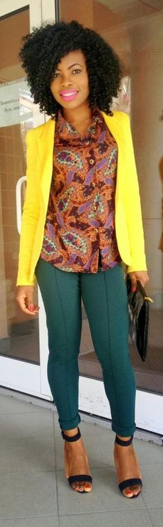 Love how she paired the yellow blazer with a printed shirt & tapered pants