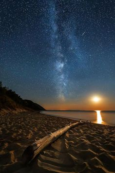 """Some nights the stars align (ha!), and you get lucky with an astrophotography hat trick! Standing on the still and silent Empire Beach, I watched the moon paint the sky orange as it set beneath a sparkling Milky Way adorned with three meteors. A perfect night cap, in my book!  Also, there is an opening in my upcoming night sky workshop! Click the """"Book Now"""" button on my page for more info"""
