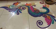 Make these beautiful Peacock Rangoli Designs for Diwali. You can also make these freehand, simple Peacock Rangoli Designs for competition and for new year. Rangoli Colours, Rangoli Patterns, Rangoli Ideas, Rangoli Designs Diwali, Ganesh Rangoli, Peacock Rangoli, Kolam Rangoli, Indian Rangoli, Ganesha Art