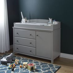 Features:  -Accessories not included.  -Cotton Candy collection.  -Soft gray color.  -Metal knobs in a brushed nickel finish.  -Changing station is removable, allowing for a transformation into a ches
