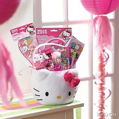Make a sweet Easter basket with a plush Hello Kitty basket filled with bright pink grass and goodies!