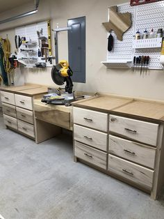 These plans are great for building out your shop. This miter station has so many drawers, you won't know what to do with all the space. The perfect excuse to add more tools to your collection! Garage Cabinets, Wooden Cabinets, Wooden Shelves, Workshop Cabinets, Diy Garage Storage, Shop Storage, Garage Organization, Bike Storage, Workshop Layout