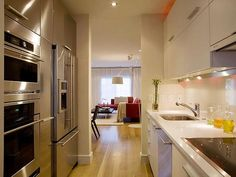 I'm intrigued by the giant appliances in this tiny galley kitchen. And a little frightened by the idea of producing an entire Thanksgiving dinner with so little counter space. ;)