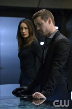 """Nikita -- """"Black Badge"""" -- Image NK311a_0095 -- Pictured (L-R): Maggie Q as Nikita and Shane West as Michael -- Credit: Ben Mark Holzberg/The CW -- © 2013 The CW Network. All Rights Reserved"""