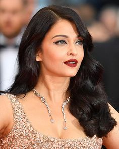 This Actress May Have the Best Makeup at the Cannes Film Festival: Aishwarya Rai Old Hollywood glam -- cat eye and red lipstick   allure.com