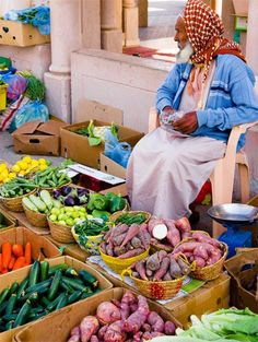 A vegetable seller at Nizwa market in Oman by Alan Wilkinson, from Suffolk