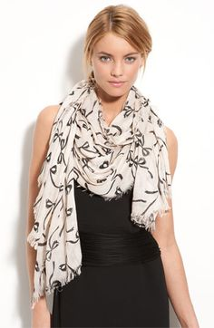 I have an obsession with bows. i'm totally buying this scarf. so cute.