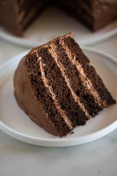 A simple, moist, layered chocolate cake, filled with dark chocolate mousse, and then a warm chocolate frosting poured on top!