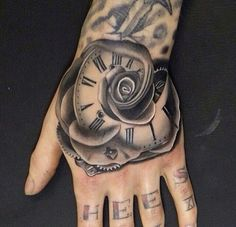 Steampunk hand clock flower tattoo