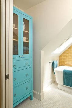 Great storage idea for the bathroom - nothing a little Annie Sloan Chalk Paint (in Florence) couldn't do! (eclectic bathroom by Renewal Design-Build)