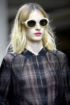 Officially the SUNGLASSES OF THE SEASON: by  DRIES VAN NOTEN and better with bleached hair and several inch roots like Kurt Cobain