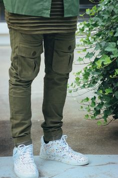 Awesome way to layer different shades of green with a pop of white shoes!