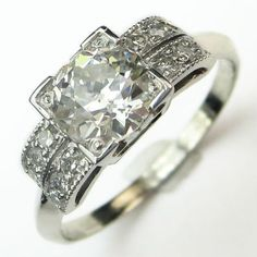 Layer Cake: This is a beautiful diamond, a chunky twinkly old European cut that faces up so white, it almost glows set in a new hand made homage to an original 1920's setting. Maloys.com