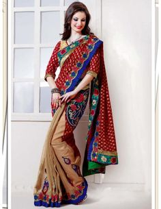 Grandiose maroon, beige saree is created on chiffon and tissue with foil print buttis on pallu part.