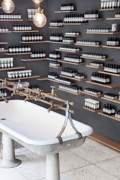 Aesop University Place - references concrete, oak and industrial; designed by architect Jeremy Barbour of Tacklebox, alongside Aesop Creative Manager Hiroko Shiratori.The store's sink was salvaged from the Bethlehem Steel plant in Pennsylvania. Retail Store Design, Retail Shop, Retail Displays, Shop Displays, Window Displays, Commercial Design, Commercial Interiors, Aesop Store, Vitrine Design