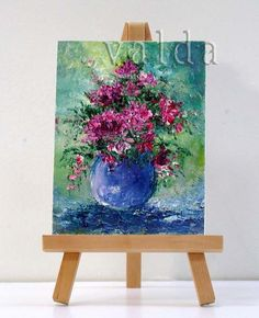 Beautiful deep shades of pinks and burgundies, with shades of greens blues and aqua colors. Bouquet of mixed floral arrangement. High textured, where the flowers really stand out.  Using Impressionistic style with textural method. This adds dimension to the painting.  This beautiful floral painting includes the stand, and can be placed anywhere.  It is also a great original gift ,suitable for any occasion.  I use top quality oils made by Winsor And Newton. They are light fast and keep their…