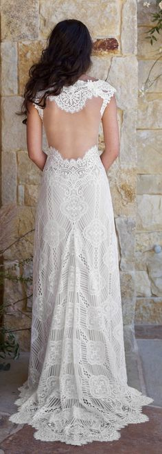 Calistoga Gown by Claire Pettibone | A bold geometric lace A-line gown features a dramatic sheer illusion back, sweetheart neckline and sweep train. Lined in Nude crepe as shown, or Ivory.