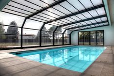 Pool ideas indoor outdoor retractable pool enclosure sun for Abrisud pool covers