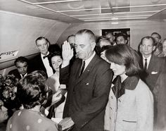 """The First Lady was there when the President was killed, of course. She famously stood next to Lyndon B. Johnson when he took the presidential oath of office on Air Force One. She was still wearing the blood-stained pink suit that she'd been wearing all day.  """"I want them to see what they have done to Jack,"""" she told Lady Bird Johnson."""