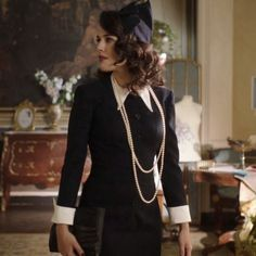 Vintage 1940s Fashion from Spanish TV Show El Tiempo Entre Costuras- The Time in Between | Black Dress with White Collar/Cuffs, Pearls, & Hat