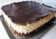 Peanut Butter Cheesecake with a Brownie Crust  Omg, I bet this is to die for!!