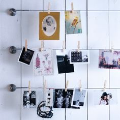 Photos and pictures hung on DIGNITET curtain wire