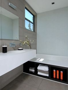 We love the holistic design approach of this bathroom - Integrated Corian® sinks & tub storage. Via Maydan Architects