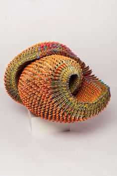 'Orange Shell' (2014) by Nashville-based American artist Alex Lockwood. Lottery tickets, 18 x 12 x 13 in. source: the artist's site. via Contemporary Basketry