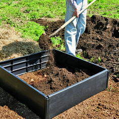"""Potatoes. This grew the most uniform and largest harvest.  7 methods were tried here.  2 parts topsoil to 1 part compost. used. a few inches of soil compost at base with 3"""" top soil over potato seeds, with spacing ~12"""" apart. Takes a lot of decent soil."""