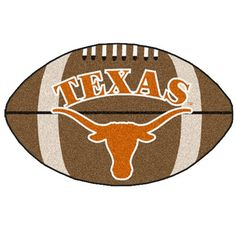 For all those football fans out there! Show your team loyalty with a FANMAT! Football-shaped area rugs by FANMATS. Made in U.S.A.  100% nylon carpet and non-skid Duragon® latex backing.  Machine washable.  Officially licensed.  Chromojet painted in true team colors.