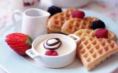 Amazing fruits and waffles breakfast.