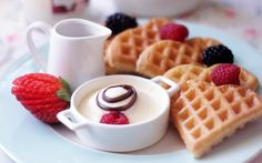 Amazing fruits and waffles breakfast.