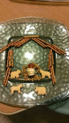 Nativity snack for kids. Pretzel stall, granola manger, little smokie Jesus wrapped in swaddling tortilla :-) surrounded by animal crackers. Probably one of my favorite daycare snacks ive done so far!!!