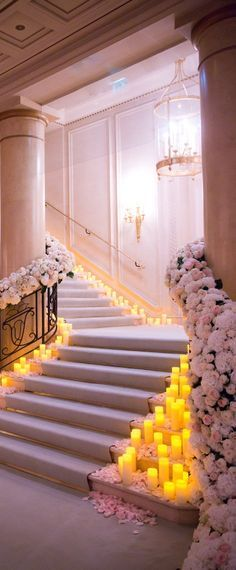 Grand staircase with white flowers lined along the side.