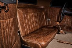 Distressed leather continues to be a hot material for vintage or traditionally flavored rods such as this '33 Ford coupe stitched by Rip Stitch Upholstery. Also note the use of square weave carpet. (Photo courtesy Anthony Ross Tyler)