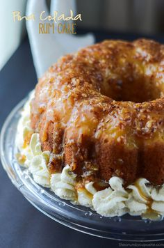 Pina Colada Rum Cake - A moist, boozy upside-down rum cake, infused with everything coconut, a pineapple halo, and toasted coconut caramel sauce.