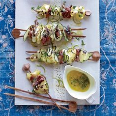 Grilled Squash Ribbons and Prosciutto with Mint Dressing | Grilling zucchini and summer squash ribbons on skewers is terrific because the edges become wonderfully charred and crisp, while the insides stay tender and juicy.