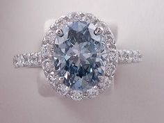 Amazing 3.00 ctw Oval Cut Diamond Engagement Ring with a 2.15 Carat Fancy Intense Blue Oval Cut Lab #engagementring #diamondengagementring