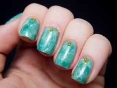 Be bold and bright with these green jade nails!